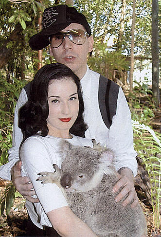 marilyn manson looking dorky and dita von teese holding a koala